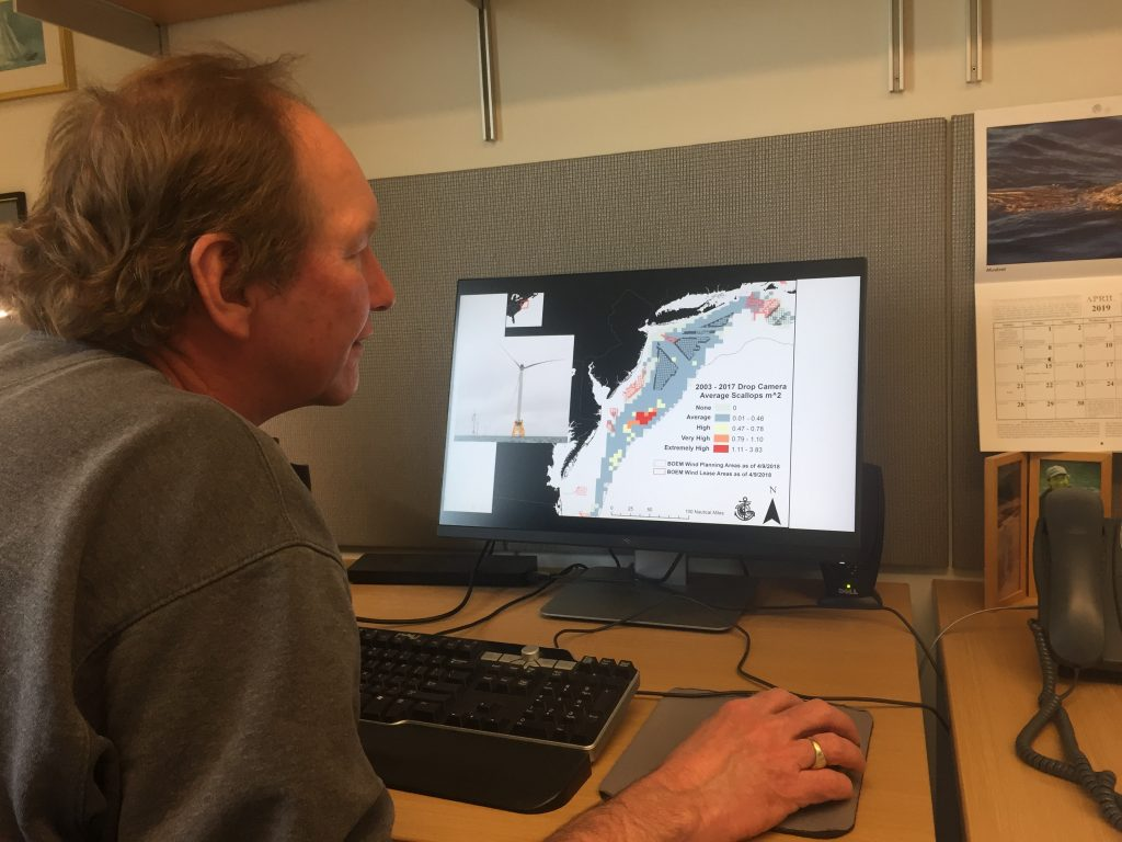 Dr. Kevin Stokesbury shows a map of scallop surveys and proposed offshore wind farms in the Mid-Atlantic. Photo by Nadine Sebai for The Public's Radio