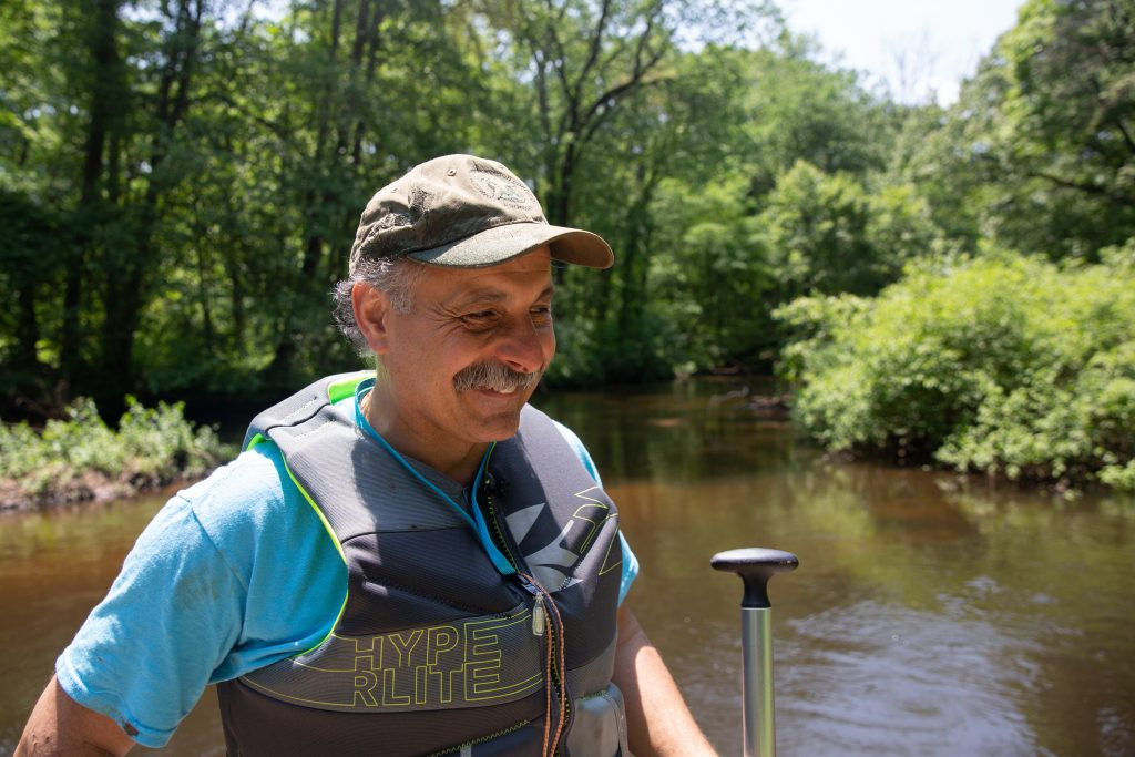 "Wildlife biologist Peter Picone, above, has spent much of his life paddling the Quinnipiac. ""It's an adventure,"" he said. ""Every bend has something different."" Photo by Patrick Skahill for WNPR."