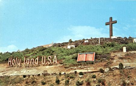 A postcard featuring the sign and cross at Holy Land, USA. Courtesy of Davis Dunavin