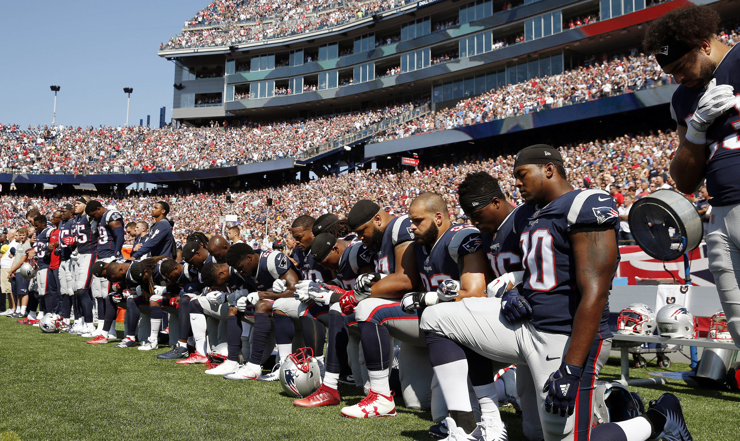 football players new england patriots take a knee national anthem