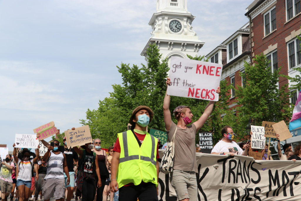 Masked demonstrators take part in the Black Trans Lives Matter march in Portsmouth, N.H., on June 28, 2020. (Dan Tuohy/NHPR)