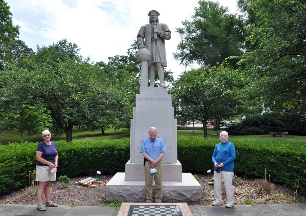 """Researchers Ellen Madison (left), John Corduri, and Linda Chaffee, authors of """"Built From Stone: The Westerly Granite Story"""" in front of the Christopher Columbus statue in Westerly, R.I. (Alex Nunes/The Public's Radio)"""