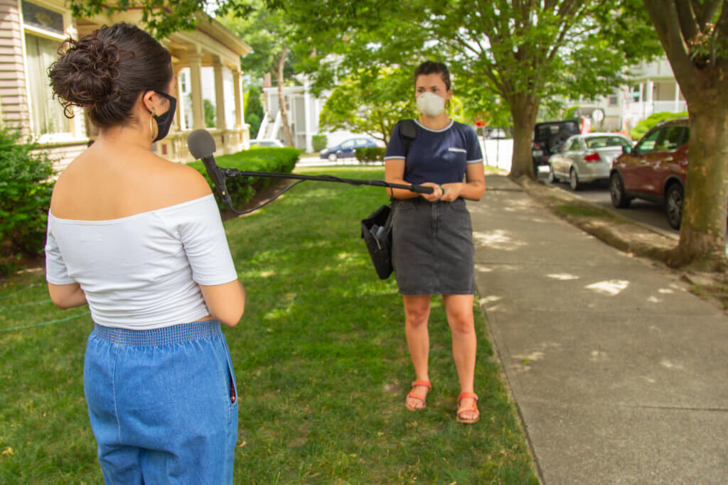 Mosaic Host Ana González and Mikayla outside Mikayla's off-campus apartment in Rhode Island. (Cheryl Adams/The Public's Radio)