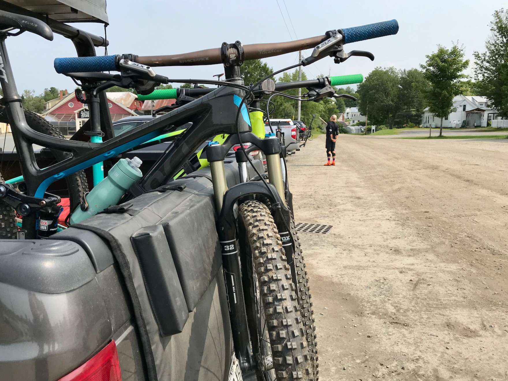 Two mountain bikes sit in a truck bed
