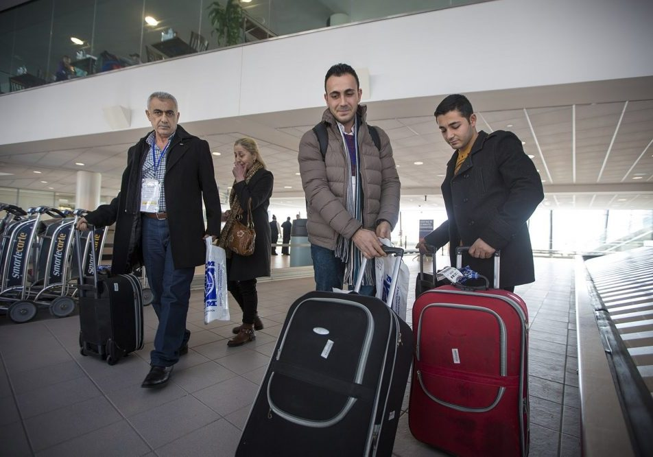 From left to right, Mohamad, Zeinab, Rashid and Ahmad Mahmoud arrive at Manchester-Boston Regional Airport in New Hampshire. Photo by Jesse Costa for WBUR.
