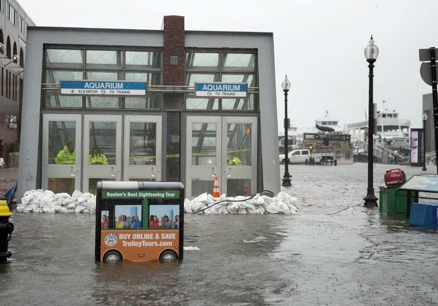 Sandbags hold back water at the entrance to the Aquarium MBTA station during the March 2 nor'easter. Photo by Robin Lubbock for WBUR