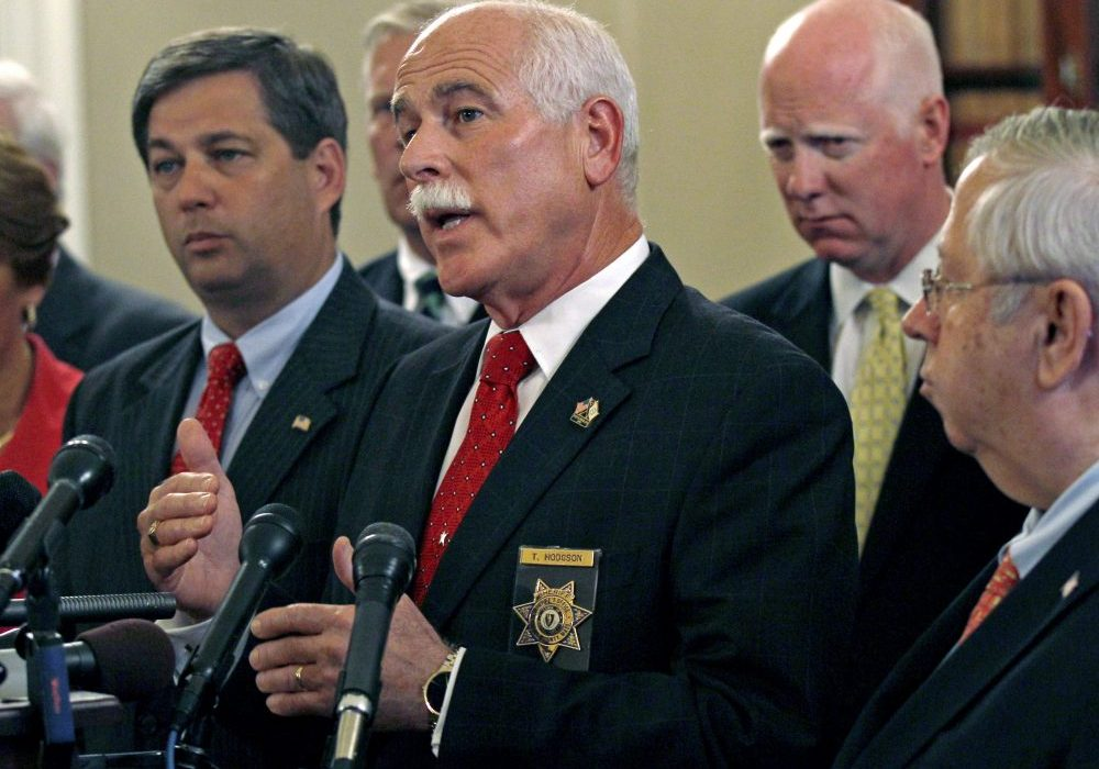 Bristol County Sheriff Thomas Hodgson gestures during a news conference at the State House in Boston in 2011. Photo by Charles Krupa for the Associated Press
