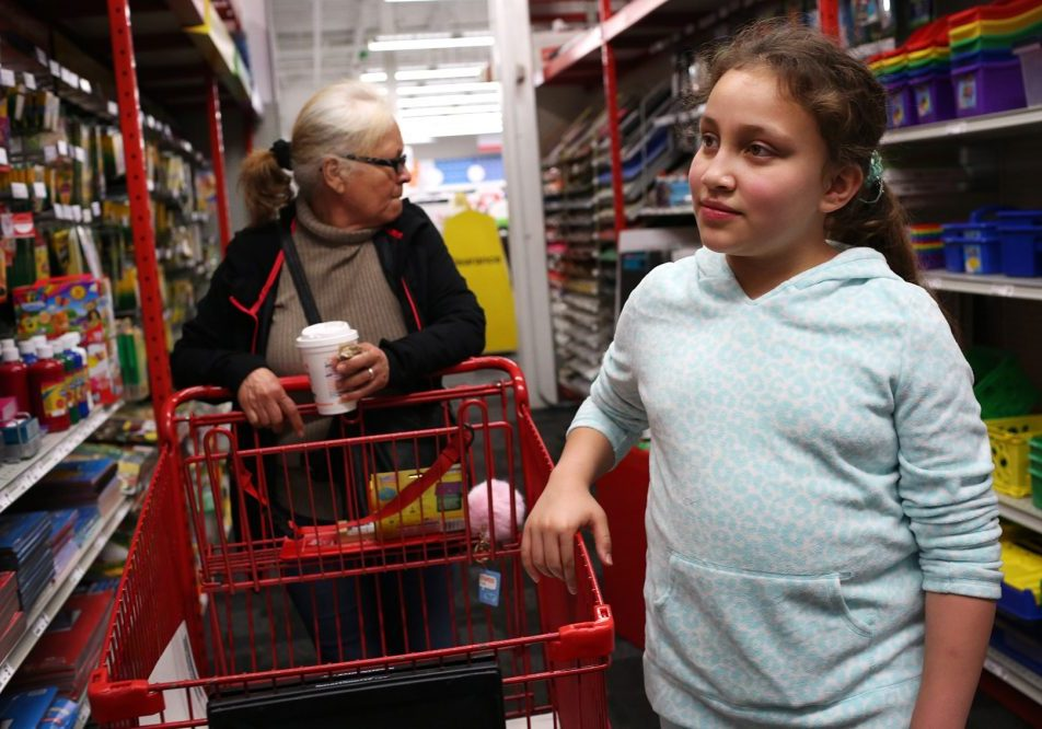 Mellanie Rodriguez, Francisco Rodriguez's 10-year-old daughter, goes shopping for school supplies with her grandmother, Jesus Rodriguez, on Saturday. Photo by Hadley Green for WBUR