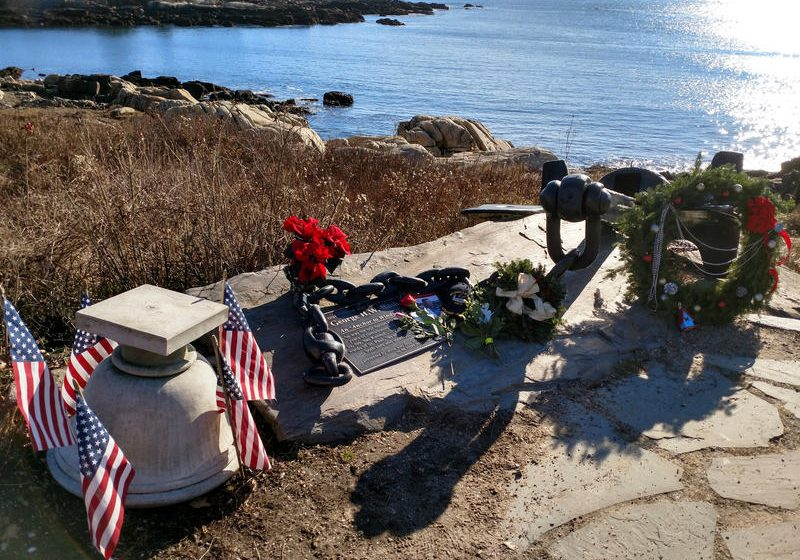 Flowers and wreaths adorn a naval anchor honoring President George H.W. Bush on a bluff overlooking Walker's Point in Kennebunkport on Saturday, Dec. 1, 2018. Photo by Irwin Gratz for Maine Public