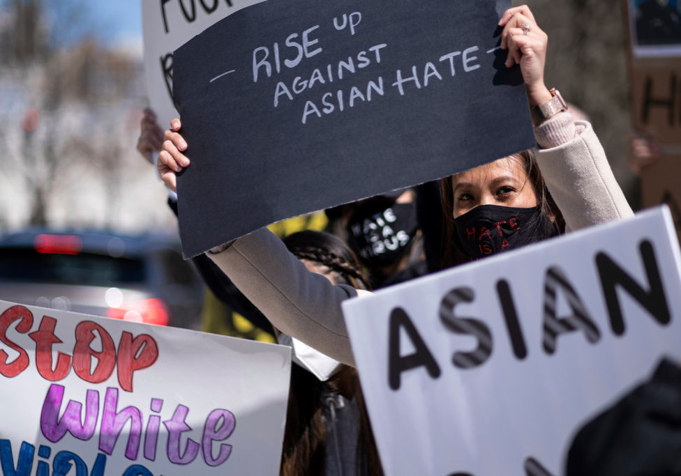 "Mai Wright holds a sign while participating in a ""Stop Asian Hate"" rally outside the Georgia State Capitol in Atlanta on March 20, 2021. (Ben Gray/AP Photo)"