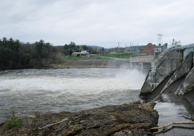 Whitewater rushes out of Wilder Dam, near Hanover, in early May. Photo by Britta Greene for NHPR