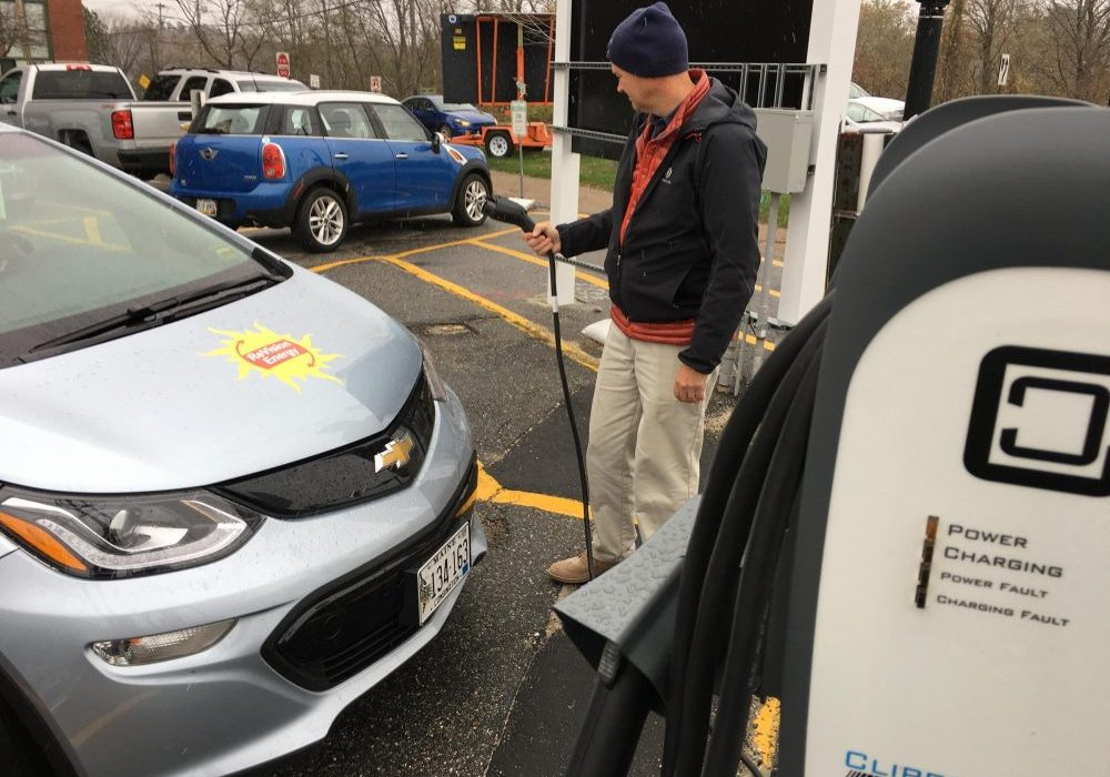 ReVision Energy's Barry Woods charges up his company car in Brunswick, Maine. Photo by Fred Bever for Maine Public
