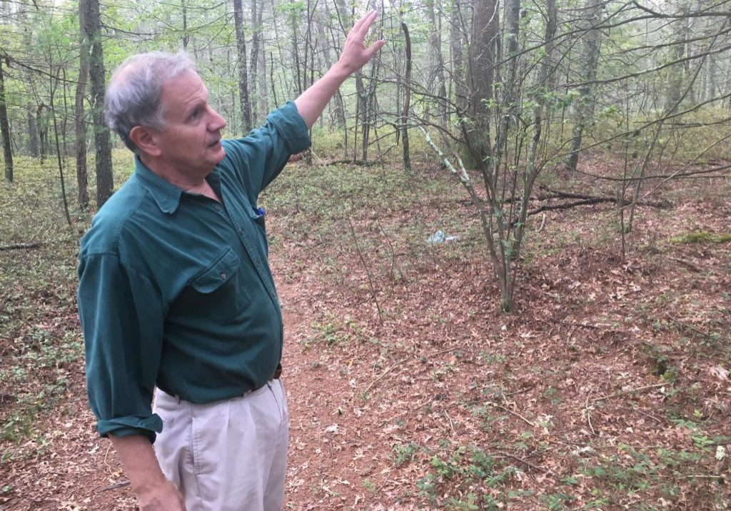 Bill Eccleston, self-proclaimed woodsman and former co-chair of Burrillville's first Comprehensive Planning Committee, discusses the habitat and species found in the George Washington Wildlife Management Area on Sept. 5, 2017. Photo by Fred Bever for Maine Public
