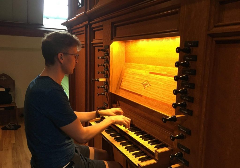 Organist Joseph Ripka at the instrument at Calvary Church. Photo by Harriet Jones for WNPR