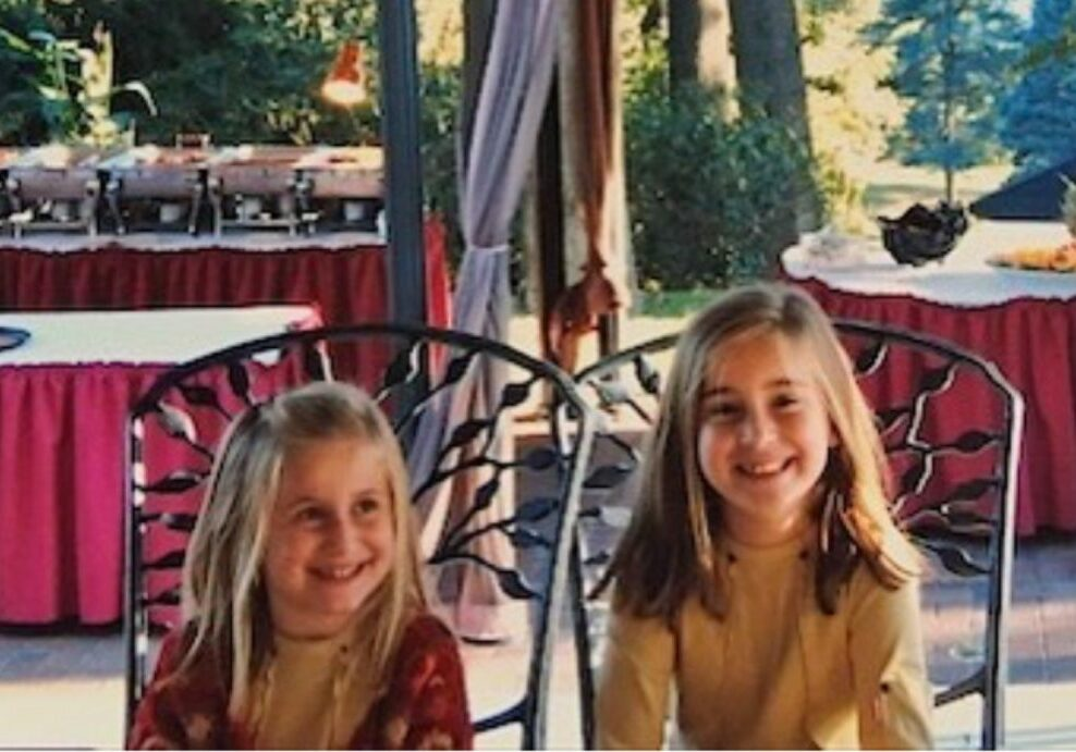 Lindsay (left) and Sophia Cook at a memorial benefit for their father, Dennis Cook, who was killed on Sept. 11, 2001. (Courtesy Lindsay Cook)