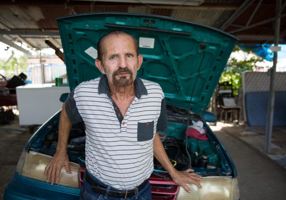 Alberto Díaz lives surrounded by cars. After Hurricane Maria's floods, none of them work. When Díaz built his house in Valle Hill, he raised his foundation so the home wouldn't flood. But Maria still brought a few feet of water inside. Photo by Ryan Caron King for Connecticut Public Radio