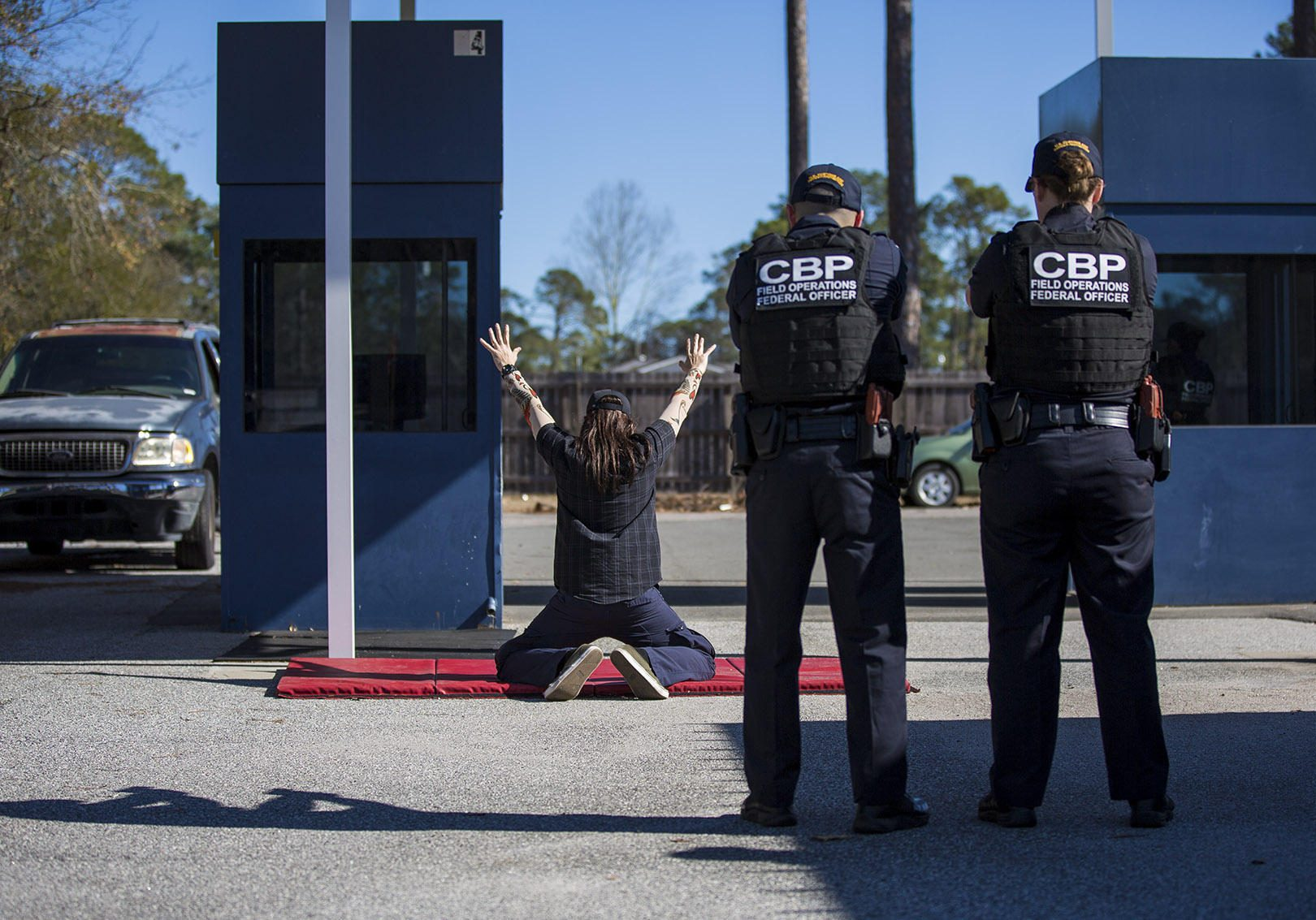 At the federal law enforcement training center in Brunswick, Georgia, U.S. Customs and Border Protection officer trainees conduct a border crossing drill. Photo by Jesse Costa for WBUR