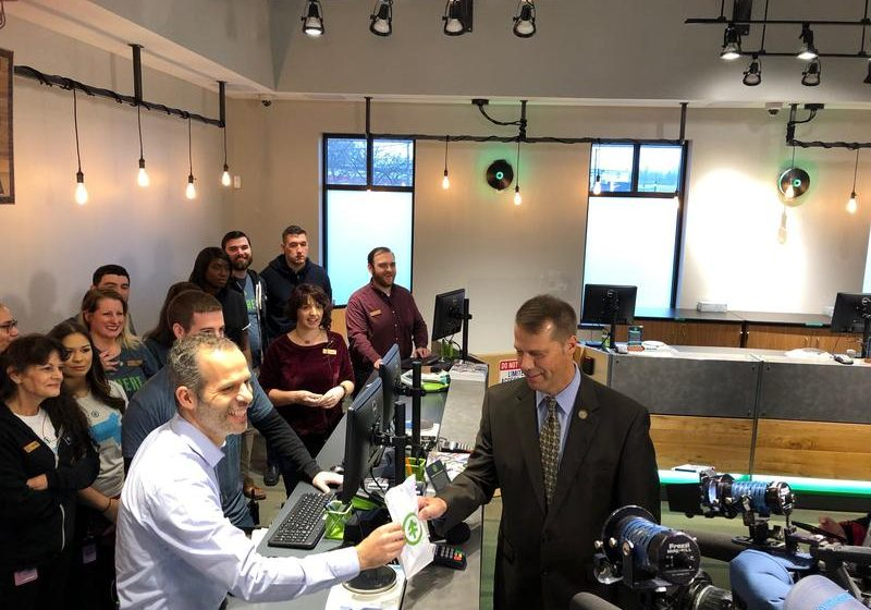 Northampton Mayor David Narkewicz makes the first purchase at NETA from co-owner Arnon Vered on Tuesday. Photo by Alden Bourne for NEPR