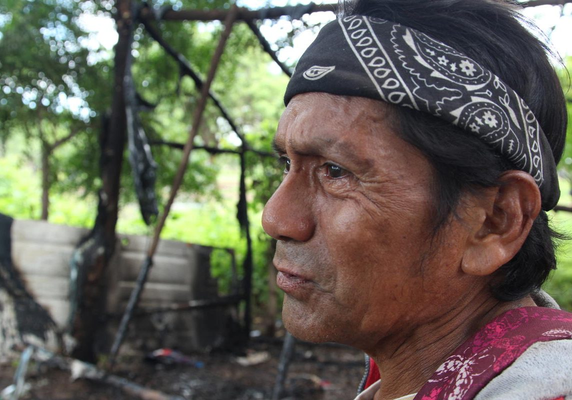 Rafael Morales stands in front of his home hours after he and neighbors allege Nicaraguan police burned it down. The motive for the attack is unclear as Morales said he is a Sandinista government supporter. Photo by Lorne Matalon for VPR