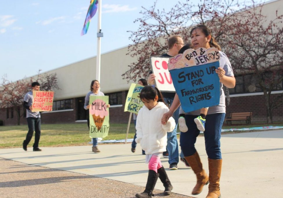 Dairy worker Yessica Sanchez and her children were among protestors outside the Ben & Jerry's offices on Tuesday. Sanchez says the unsanitary conditions at the farm have made her children sick. Photo by Kathleen Masterson for VPR